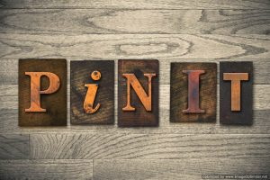 """The words """"PIN IT"""" written in wooden letterpress type."""